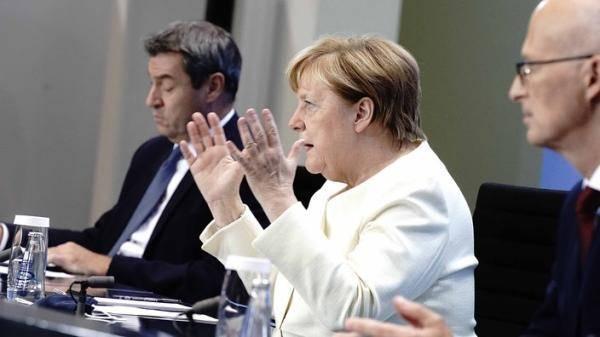 德国新冠峰会推出新防疫限制措施 默克尔:必须避免第二次全国性封锁