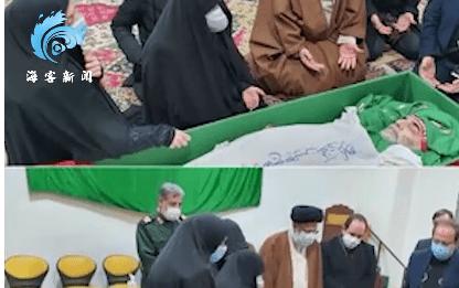百事3首页伊朗核科学家葬礼举行:亲属哽咽抚摸面颊,棺椁覆盖国旗