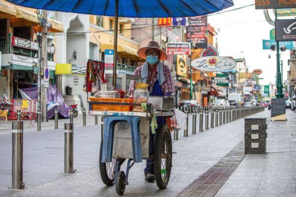 """塑料瓶""""变身""""防护服,泰国抗疫环保两不误"""